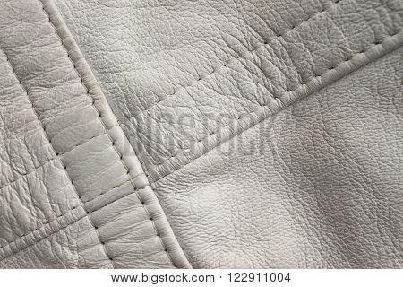 White leather close up. Diagonal stitch detail
