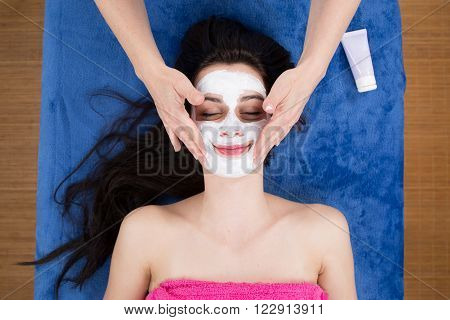 Woman Getting A Beauty Mask At Wellness Center