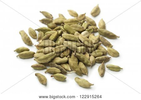 Heap of green cardamom  seeds on white background