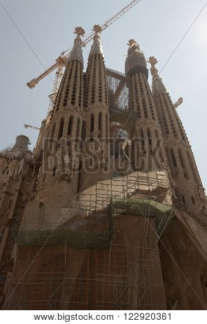 BARCELONA SPAIN - JULY 12 2013: The Basilica i Temple Expiatori de la Sagrada Familia - a large Roman Catholic church in Barcelona designed by Catalan architect Antonio Gaudi. Construction began in 1882 and continues today.