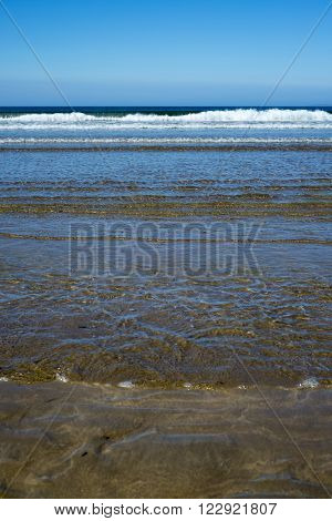 calm soft waves lashing onto ballybunion beach in county kerry ireland