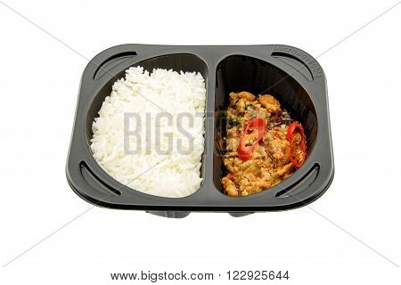 Stir-fried basil chicken with Jasmine rice an innovative instant meal for a hectic life preparing by putting in a microwave just for a few minutes. Found in most famous convenience stores in Thailand.