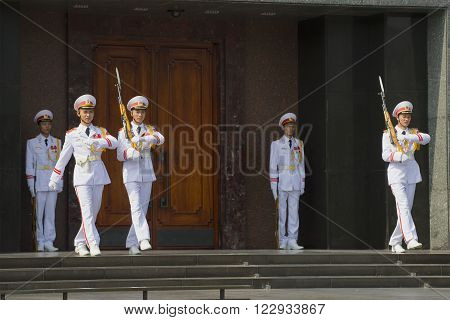 HANOI, VIETNAM - JANUARY 10, 2016: Changing of the guard at the door of the Ho Chi Minh mausoleum in Hanoi. The Ho Chi Minh mausoleum is the main attraction of Vietnam