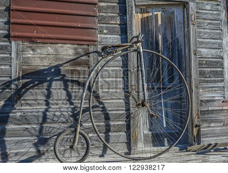 The first all metal bicycle was developed sometime in the 1870s.  Large front wheels meant riders could go faster because the larger the wheel the farther the bike traveled with each wheel rotation.