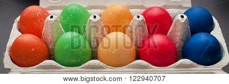 Colored Easter Eggs In An Egg Box