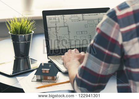 architect interior designer occupation - man working on new house project at office