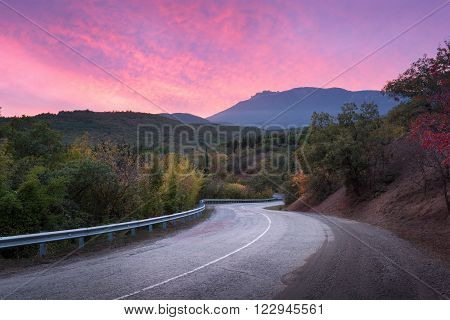 Mountain Road Through The Forest At Colorful Sunset