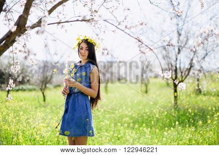Girl With Flowers In Spring Blossom Alley