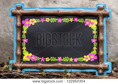 A luau chalkboard decoration for a party