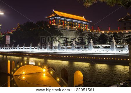 Illuminated famous ancient Bell Tower at night. China,  Xian
