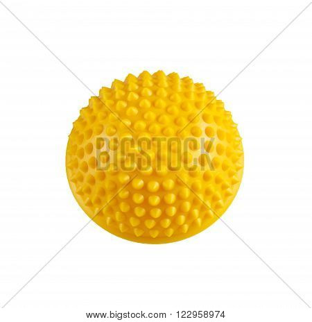 Yellow massage hemisphere for stress relief and rehabilitation isolated on a white background