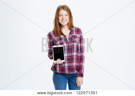 Happy young woman showing blank tablet computer screen isolated on a white background