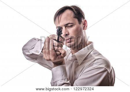 A man in a white shirt with a gun takes aim
