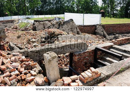 Auschwitz II - Birkenau Crematorium II ruins with the underground disrobing chamber on the right and the gas chamber on the far left
