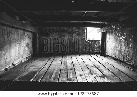 Auschwitz II - Birkenau aspect of beds at the interior of a brick walled barracks