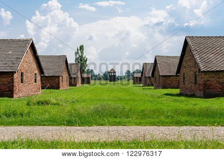 Auschwitz II - Birkenau brick barracks and medium sized watch tower