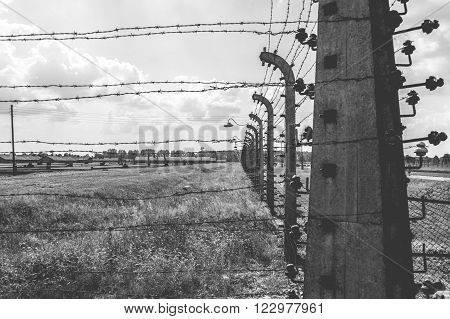 OSWIECIM, POLAND - JULY 3, 2009: Auschwitz II - Birkenau, aspect of the electrified barbed wire fence