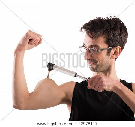 Man inflates his muscles with a pump