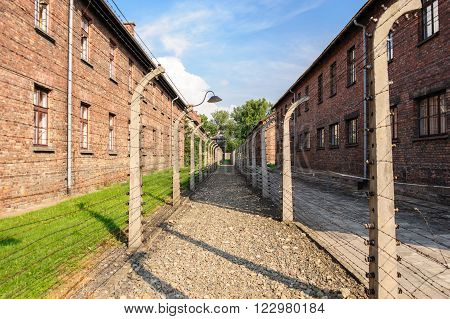 OSWIECIM, POLAND - JULY 3, 2009: Auschwitz I - Birkenau in between the inner and outer north east perimeter fence