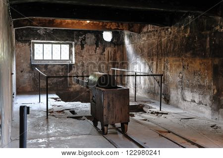OSWIECIM POLAND - JULY 3 2009: Auschwitz I - Birkenau ovens and equipment in the crematorium are all reproductions representing double-muffle single-door ovens