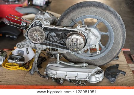 Part of a motorcycle engine in repair of the damage,Garage shop