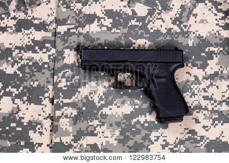 Military battle dress uniform and side arm
