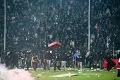 Thessaloniki Greece - March 02 2016: PAOK fans getting arrested after clashing with riot police during the semifinal Greek Cup game between PAOK and Olympiacos played at Toumba stadium poster