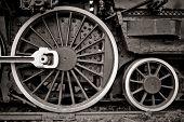 steam locomotive wheel detail in warm black and white poster