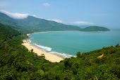 Beautiful landscape of Lang Co beach from Hai Van mountain pass wonderful shape of nature with green jungle place for eco travel at Hue Vietnam is country of sea with long seaside poster