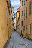 One of the many narrow streets paved with cobblestones in the old town of Stockholm - Gamla Stan. Sweden. poster