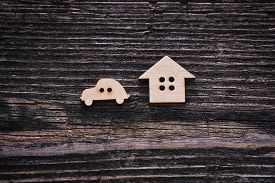 The House And Car On Wooden Background