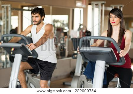Group of people working out on a stationary bike