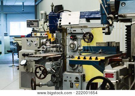 Machining shop, two vertical milling machine. Metalworking equipment