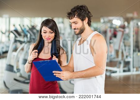 Personal trainer explaining an exercise to a woman