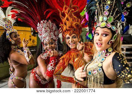 Wonderful Brazilian women wearing carnival costume