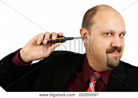Businessman With Screwdriver In The Ear