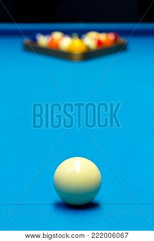 Billiard pool game eight ball with eightball balls set up on billiard table with blue cloth