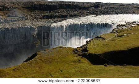 Covered by moss mountains near the largest detritus waterfall in Iceland