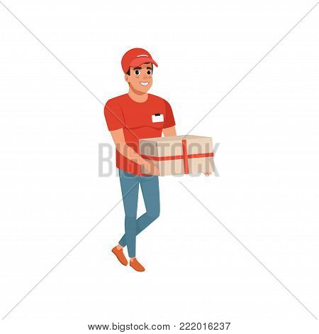 Delivery service worker with parcel in hands. Cartoon courier character in uniform red t-shirt, cap and blue jeans. Cheerful young man carrying cardboard box. Isolated flat vector illustration.