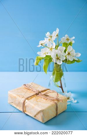 Beautiful Tender Flowering Branch And White Bench With Hole In Form Of Heart On Blue Wooden Backgrou