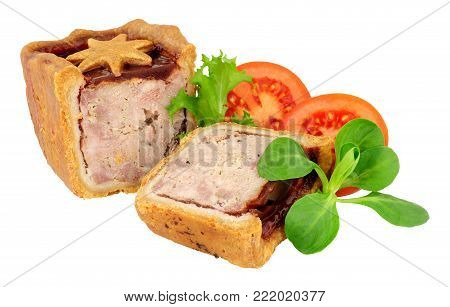 Cranberry sauce topped pork pie decorated with a pastry star isolated on a white background