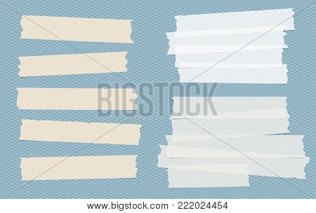Brown and white different size adhesive, sticky, masking, duct tape, paper pieces on blue squared background