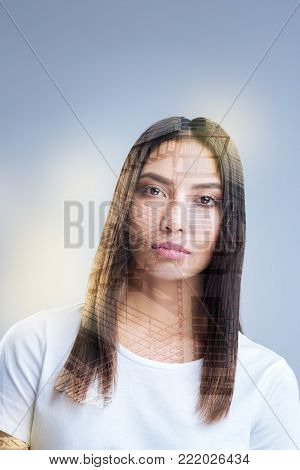 Move on. Brunette young ambitious woman looking at the camera while thinking and creating new ideas