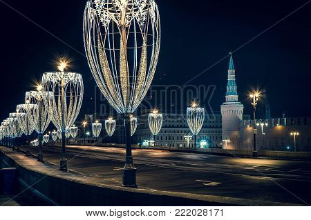 View of Kremlin tower on the Red Square from bridge with Chrismas illuminationas a glasses. Winter in Moscow without snow