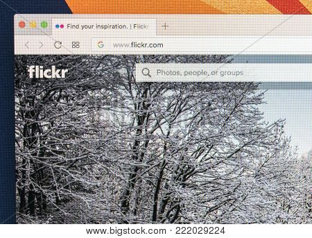 Sankt-Petersburg Russia ,January 11, 2018: Apple iMac with Flickr homepage on monitor screen. Flickr is the video hosting network website. Homepage of Flickr.com on PC computer.