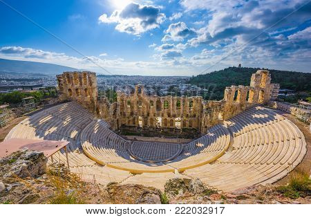 Ancient greek Odeon theater on the Acropolis slopes, Athens, Greece.