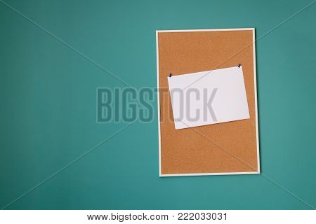 The cork board for notes on turquoise wall