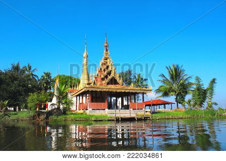 Biggest monastery and golden stupa on Inle Lake, Shan State, Myanmar(Burma). On blue sky background