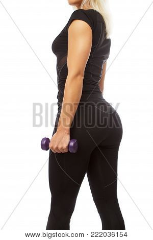 Blond woman in black sportswear doing exercises with dumbell. Isolated on white