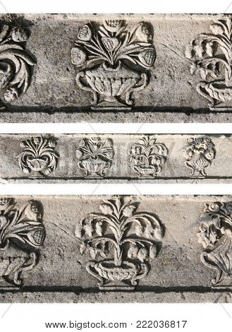 Detail of an ancient ornamental carved stone borders with floral ornaments in romanian style, Targoviste, Romania, Europe